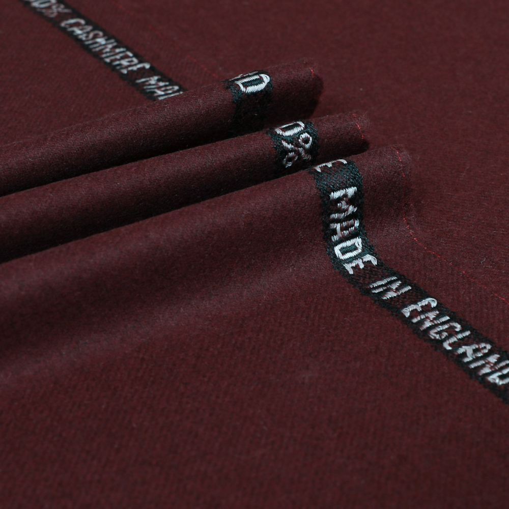 A burgundy cloth sample is displayed